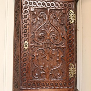 Mid 19th Century Carved Oak Corner Wall Cabinet