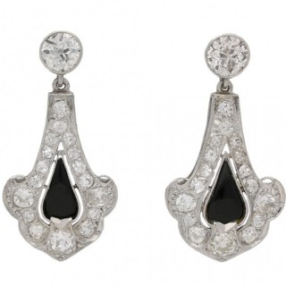 Art Deco onyx and diamond earrings, circa 1920.