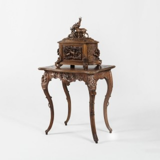 A Magnificent Carved Drinks Cabinet on Stand