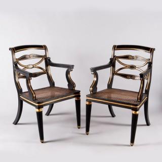 A pair of Regency parcel gilt armchairs