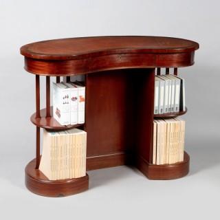 A very unusual Edwardian mahogany skeleton kidney desk