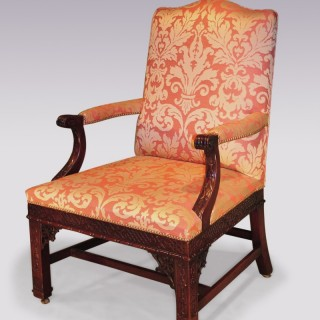 A fine 19th Century Chippendale style mahogany Gainsborough Armchair.
