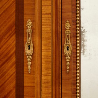 Large Parisian wardrobe adorned with marquetry and gilt bronze