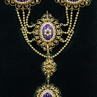 An exquisite Gilt metal Necklace with finely worked Bressan Enamel panels surrounded by Gilded filigree work in the Cannetille style with a detachable Pendant, French, Circa 1870
