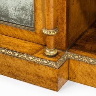 A Regency birds eye maple open bookcase