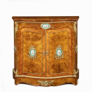 A mid-Victorian kingwood serpentine cabinet