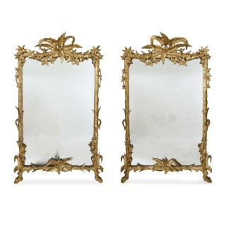Pair of large carved and gilt wood floral mirrors