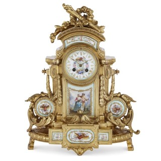 Rococo style gilt bronze mantel clock with Sèvres style porcelain plaques