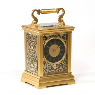 Gilt Repeating Carriage clock with Medieval theme Mask