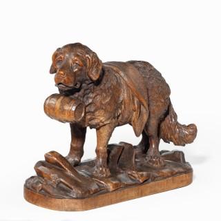 A 'Black Forest' carved linden wood model of a mount rescue dog