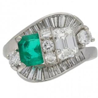 Vintage Colombian emerald and diamond crossover ballerina ring, circa 1950.