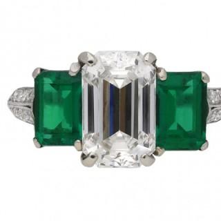 Vintage diamond and emerald three stone ring, circa 1970.