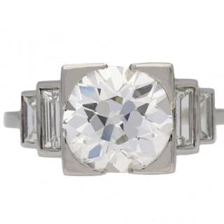 Art Deco diamond flanked solitaire ring, English, circa 1930.