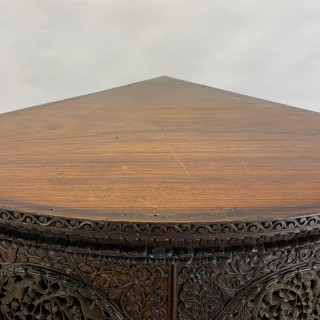 HEAVILY CARVED ANGLO INDIAN CORNER CABINET, 19TH CENTURY