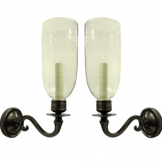 A PAIR OF REGENCY STYLE WALL LIGHTS WITH STORM SHADES