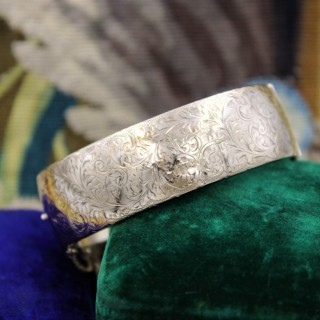An exceptional and finely engraved 9ct Yellow Gold Bangle, English, Circa 1917