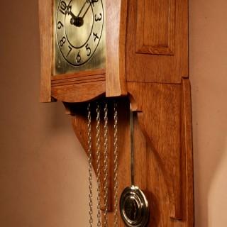 A Small Very Stylish Blond Oak Wall Clock In Bauhaus Style.