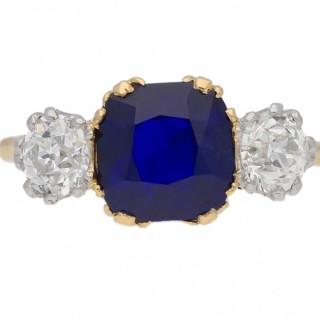 Royal Blue Burmese sapphire and diamond three stone ring, English, circa 1920.