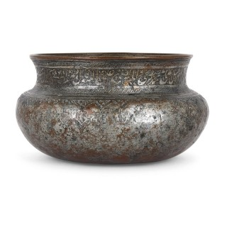 Persian copper bowl with engraved ornamental decoration