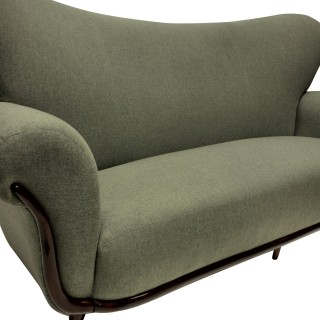 A LARGE SCULPTURAL SOFA BY ULRICH