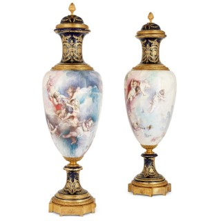 Pair of French Rococo style porcelain and gilt bronze vases