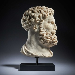 A Carved Marble Relief Bust of Hercules