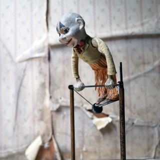 A Mechanical Hand-Crank Acrobatic Clown c.1895-1910