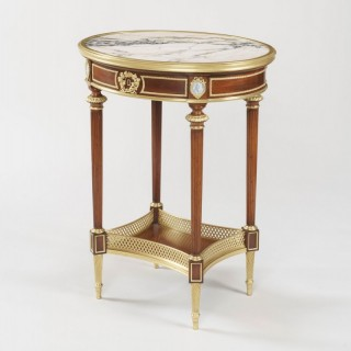 A Louis XVI Style Occasional Table By Henry Dasson
