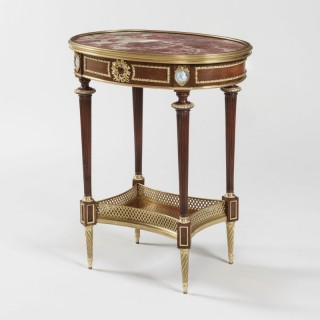 A Louis XVI Style Occasional Table In the Manner of Henry Dasson