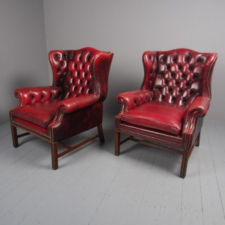 Pair of Red Leather Button Back Wing Chairs