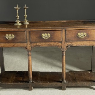 Very small 18c oak dresser base with pot board and in good original condition