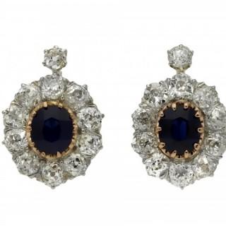Edwardian sapphire and diamond cluster earrings, circa 1910.