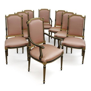 Set of eight Neoclassical style parcel gilt ebonised wood dining chairs