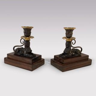 A Pair of early 19th Century  bronze & ormolu Sphinx Candlesticks