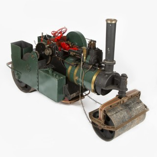 A working scale model of an Aveling & Porter steam road roller.