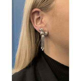 Diamond night and day bow clip earrings, circa 1930.