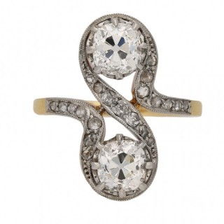 Belle Époque diamond two stone crossover ring, French, circa 1905.