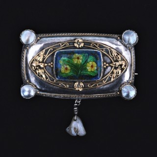 An exceptional silver, gold and enamel arts and crafts brooch