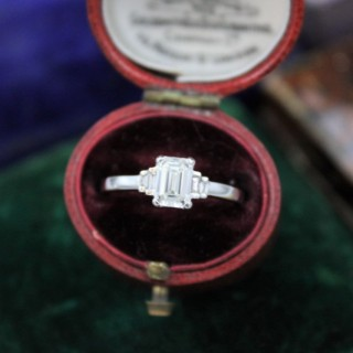A very fine Emerald Cut Diamond Ring with Baguette Cut Stepped Shoulders set in 18ct White Gold, Pre-owned