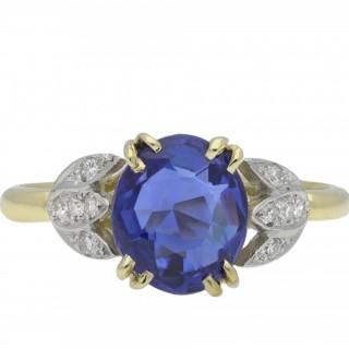 Ceylon sapphire and diamond flanked solitaire ring, circa 1915.