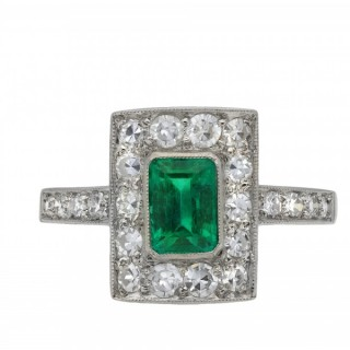 Colombian emerald and diamond cluster ring, circa 1925.