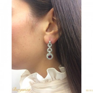 Burmese ruby and diamond earrings, circa 1935.