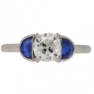 Diamond and sapphire flanked solitaire ring, English, circa 1920.