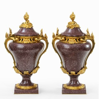 A pair Napoleon III Egyptian imperial porphyry urns and covers