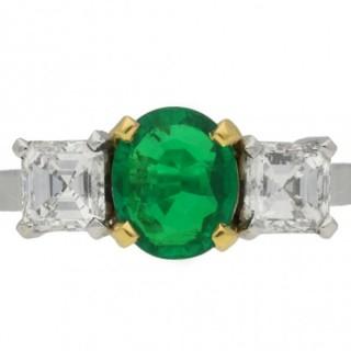Three stone emerald and diamond ring, circa 1970.