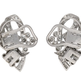 Vintage diamond night and day bow clip earrings, English, circa 1950.