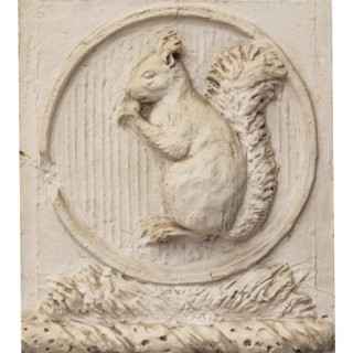 An Antique Plaster Wall Plaque of a Squirrel