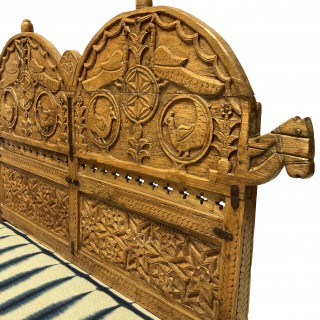 AN INDIAN CARVED TEAK FLOOR SEAT