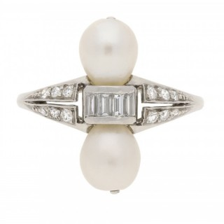 Two natural pearl and diamond ring, circa 1920.