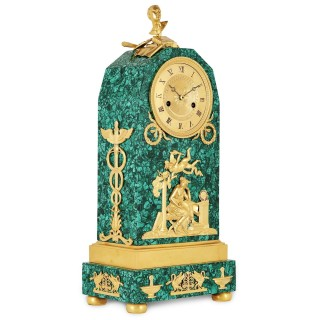 Empire period ormolu mounted malachite allegorical mantel clock